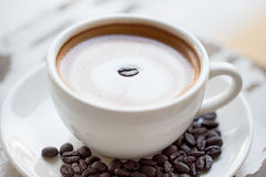 Cup of coffee on white table Royalty Free Stock Photo