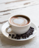 Cup of coffee on white table. Cup of cappucino coffee on white table stock image