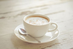Cup of coffee on white table Royalty Free Stock Photos