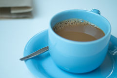 Cup of coffee on white table. At office Stock Photo
