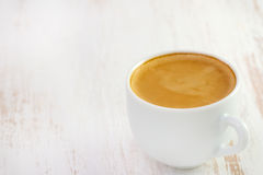 Cup of coffee on white table Stock Photos