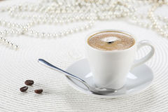 Cup of coffee  on a white wicker a mat Stock Images