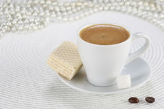 Cup of coffee on a white wicker a mat Stock Image