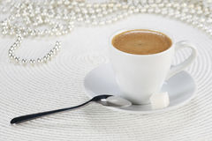 Cup of coffee on a white wicker a mat Stock Photo