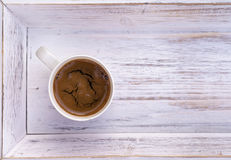 Cup of coffee on white wooden salver Stock Images