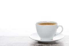 Cup of coffee on a white wooden table and space for text Stock Images