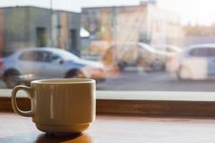 Cup of coffee by the window