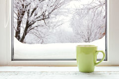 Cup of coffee on the window sill stock images
