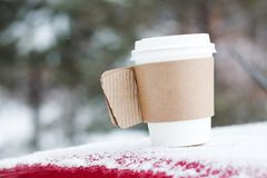 Cup of coffee. Winter paper cup of coffee with snow Stock Photography