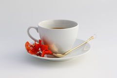 Cup of coffee. Wite cup of coffee with flowers Royalty Free Stock Photography