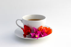 Cup of coffee. Wite cup of coffee with flowers Stock Photos