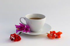 Cup of coffee. Wite cup of coffee with flowers Stock Photo