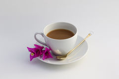 Cup of coffee. Wite cup of coffee with flowers Stock Images