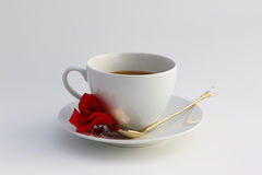 Cup of coffee. Wite cup of coffee with flowers Stock Image