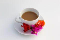 Cup of coffee. Wite cup of coffee with flowers Royalty Free Stock Images
