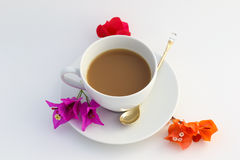 Cup of coffee. Wite cup of coffee with flowers Royalty Free Stock Photos
