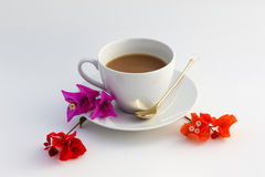 Cup of coffee. Wite cup of coffee with flowers Royalty Free Stock Photo