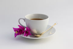 Cup of coffee. Wite cup of coffee with flowers Stock Photography