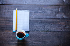 Cup of coffee witn notebook Royalty Free Stock Image