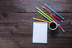 Cup of coffee witn notebook Stock Photos