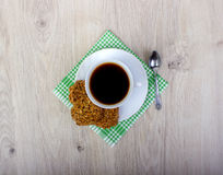 Cup of coffee wiyh pile of various shortbread and oat cookies with cereals on wooden background. Stock Photos