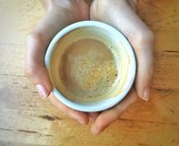 Cup of coffee in woman hands Royalty Free Stock Images