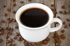 Cup of coffee on wood background Royalty Free Stock Images