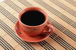 Cup of coffee. On a wood background Royalty Free Stock Image