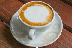 Cup of coffee on wood Stock Images