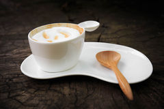 Cup of coffee with wood spoon Stock Image