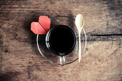 Cup of coffee with wood spoon on old wood textured and backgroun Royalty Free Stock Photos