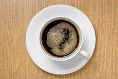 Cup of coffee on a wood surface Stock Image