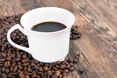 Cup of coffee on wood table. Royalty Free Stock Photo