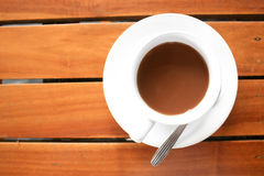 A cup of coffee on wood table Royalty Free Stock Photography