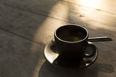 Cup of coffee. On wood table Royalty Free Stock Images