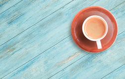 Cup of coffee on a wood table background. Royalty Free Stock Photos