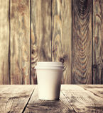 Cup of coffee on wood table Stock Images