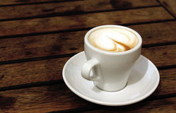 Cup of coffee. On wooden background Stock Photos