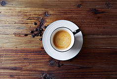 Cup of Coffee on Wooden Background Royalty Free Stock Images