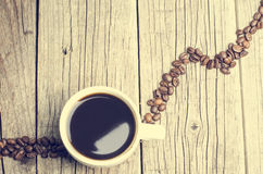 Cup of coffee on a wooden background Royalty Free Stock Photo