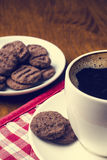 Cup of coffee on a wooden background with biscuit Royalty Free Stock Image