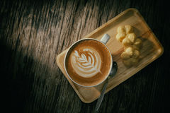 Cup of coffee on wooden background stock photography