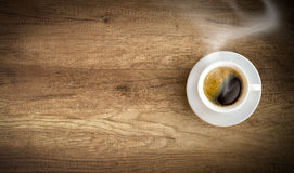 Cup of coffee on wooden background Royalty Free Stock Photography