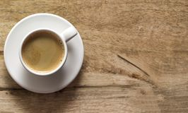 Cup of coffee. Wooden background. Copy space. Top view stock image