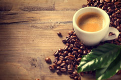 Cup of coffee on wooden background Stock Images