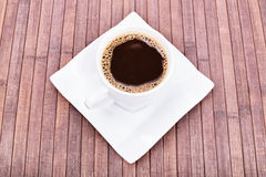 Cup of coffee. On wooden background made of bamboo Stock Photography