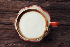 A cup of coffee on wooden background, process in vintage style Stock Image