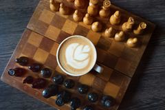 Cup of coffee on a chessboard. top view. stock photo