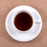 A cup of coffee. A cup of coffee on wooden board Royalty Free Stock Images