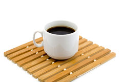 Cup of coffee on a wooden stand isolated on a white background Stock Photos